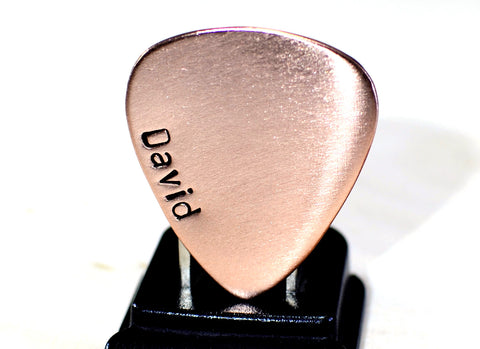 Copper guitar pick with personalized name