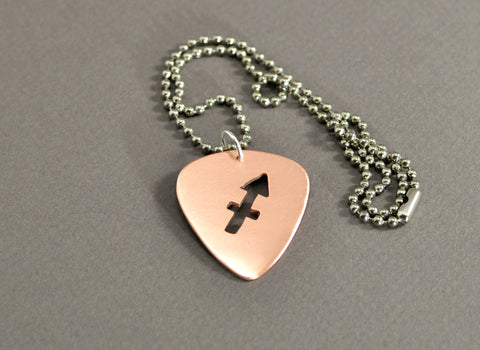 Copper guitar pick necklace with zodiac sign