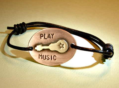 Leather bracelet with bronze guitar on copper play music edition