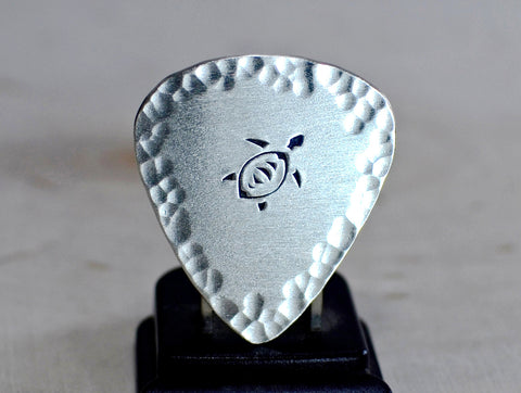Sea turtle sterling silver guitar pick with hammered design
