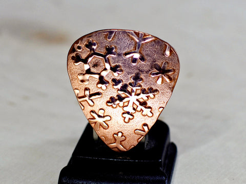Copper snowflake guitar pick for wintertime tunes