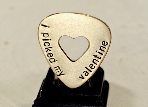Bronze guitar pick for Valentines Day with a heart and message of love