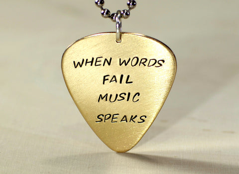 When words fail music speaks 14K yellow gold guitar pick pendant