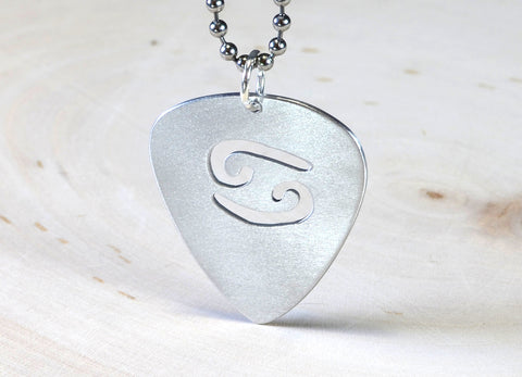 Zodiac guitar pick pendant in sterling silver with personalized horoscope sign