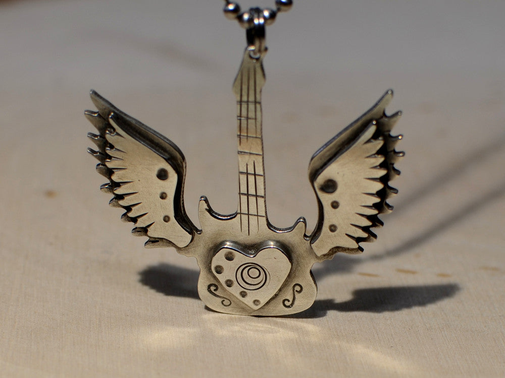 Handmade Sterling Silver Winged Guitar