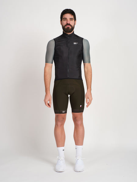 Minimalist black cycling gilet/vest with bbuc logo