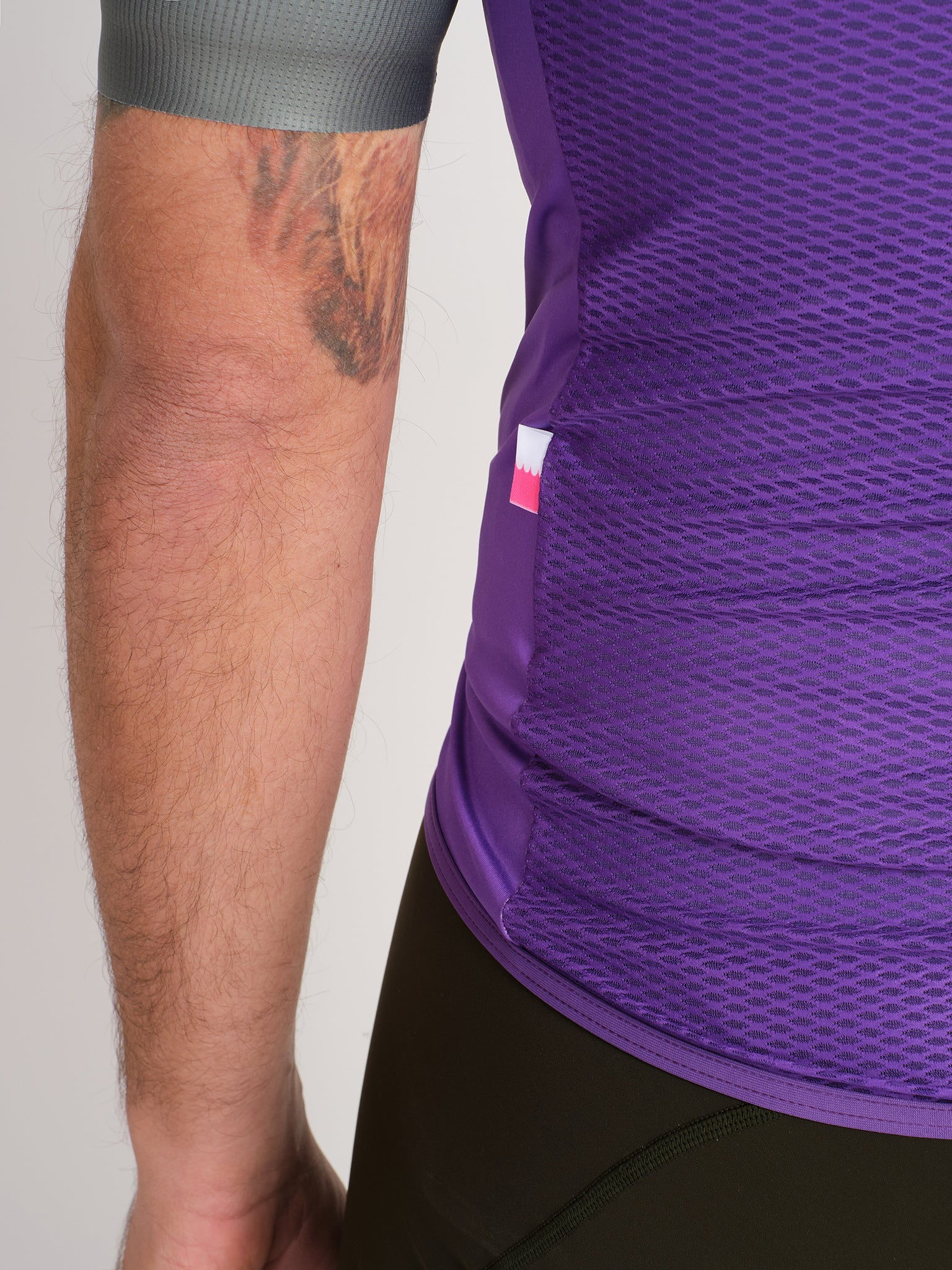 Minimalist purple cycling gilet/vest with bbuc logo