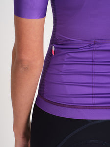 Minimalist purple cycling jersey with bbuc logo for women