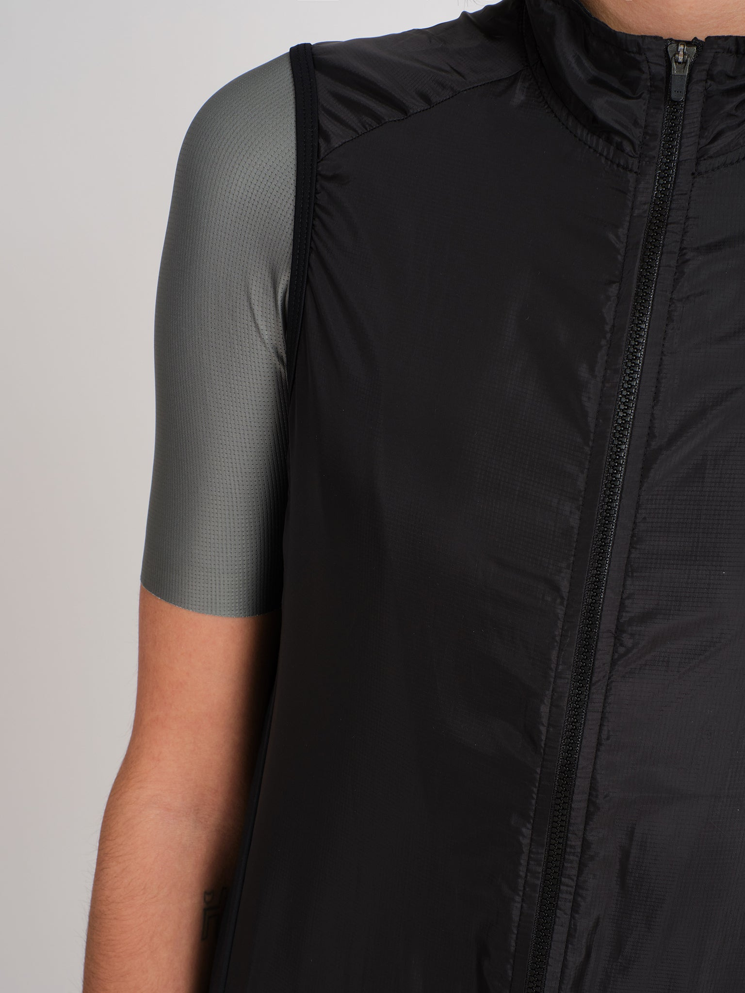 Minimalist black cycling gilet/vest with bbuc logo for women