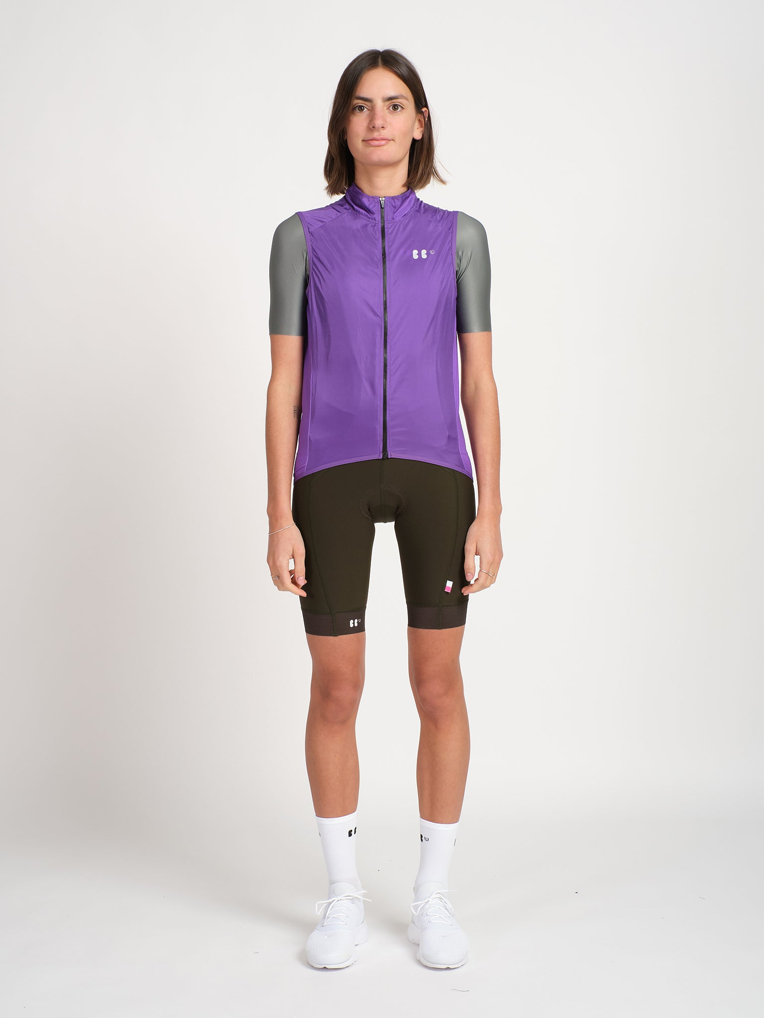 Minimalist purple cycling gilet/vest with bbuc logo for women