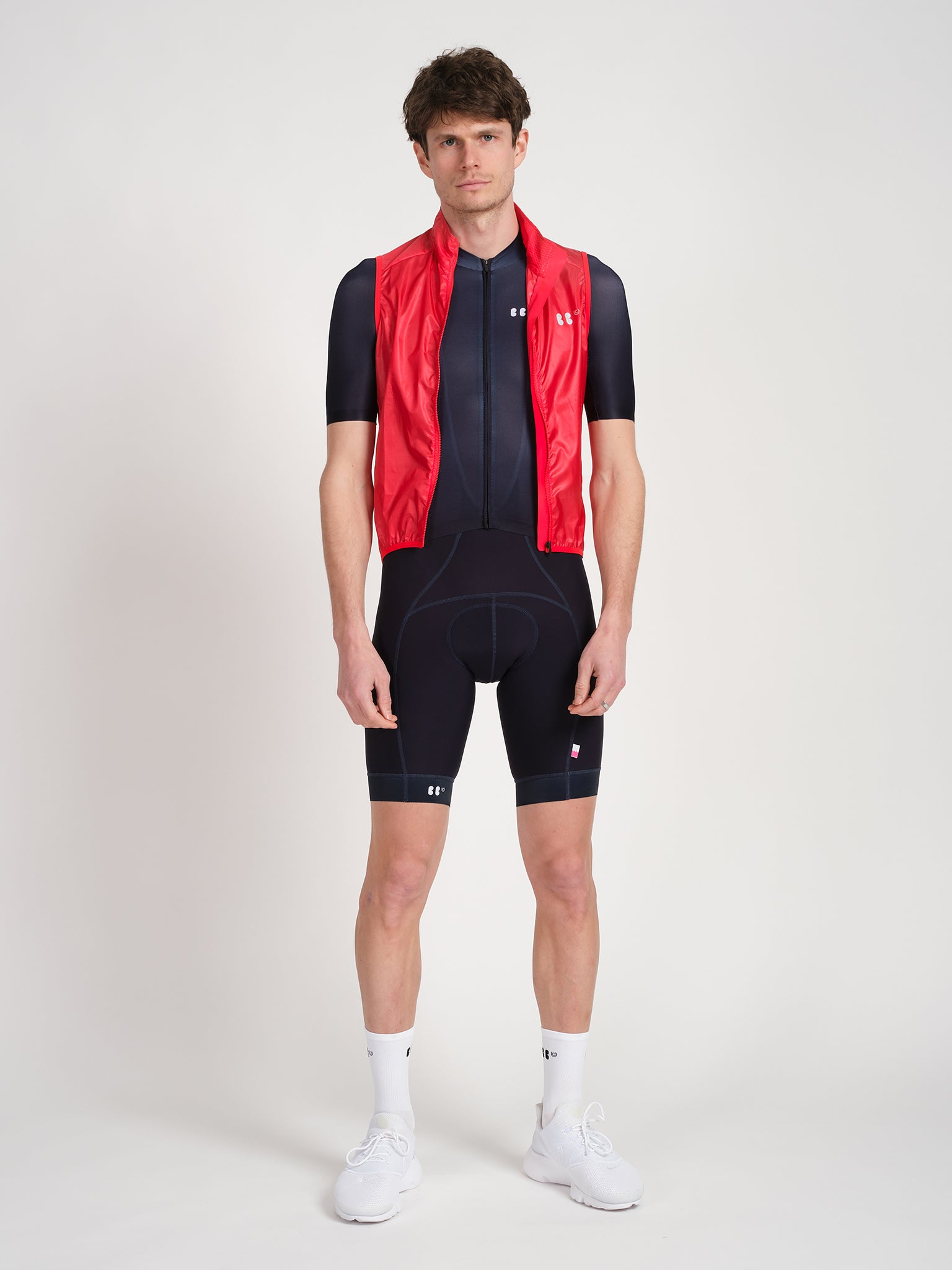 Male model wearing RD jersey with red RD gilet featuring white Racing Dream logo on back.