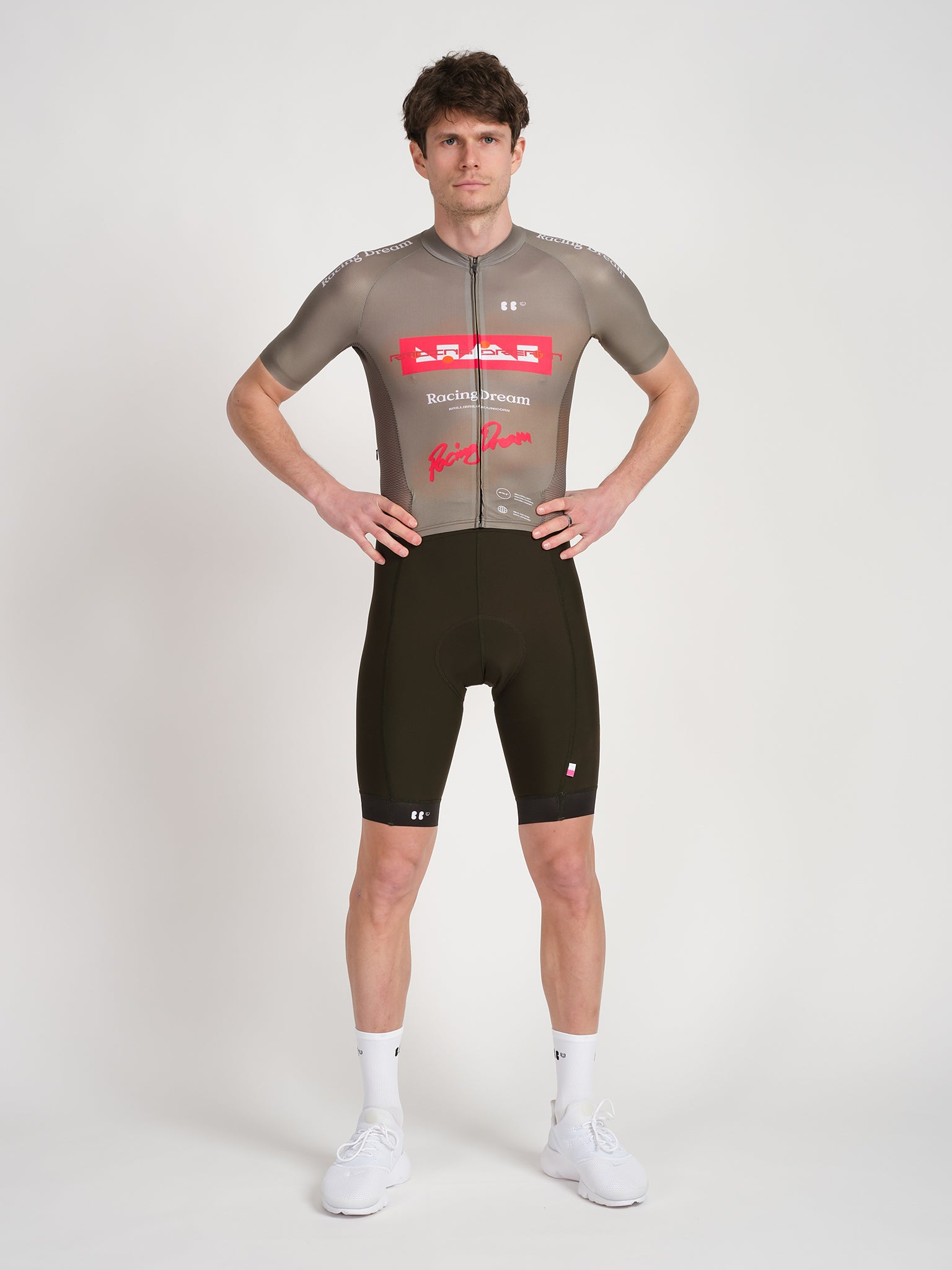Male model wearing RD skinsuit in olive with red Racing Dream logotype on chest.