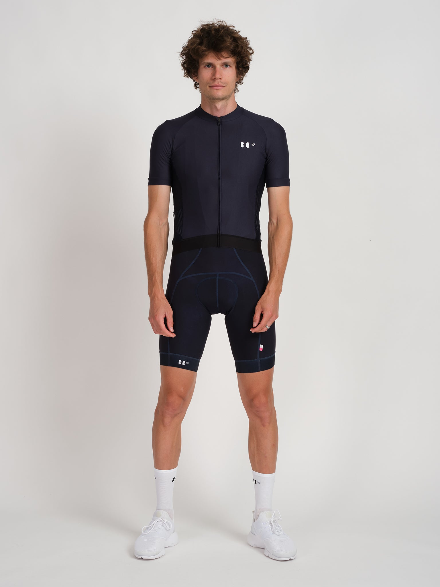 Male model wearing EDEO jersey in Navy with small BBUC logo in white on left chest