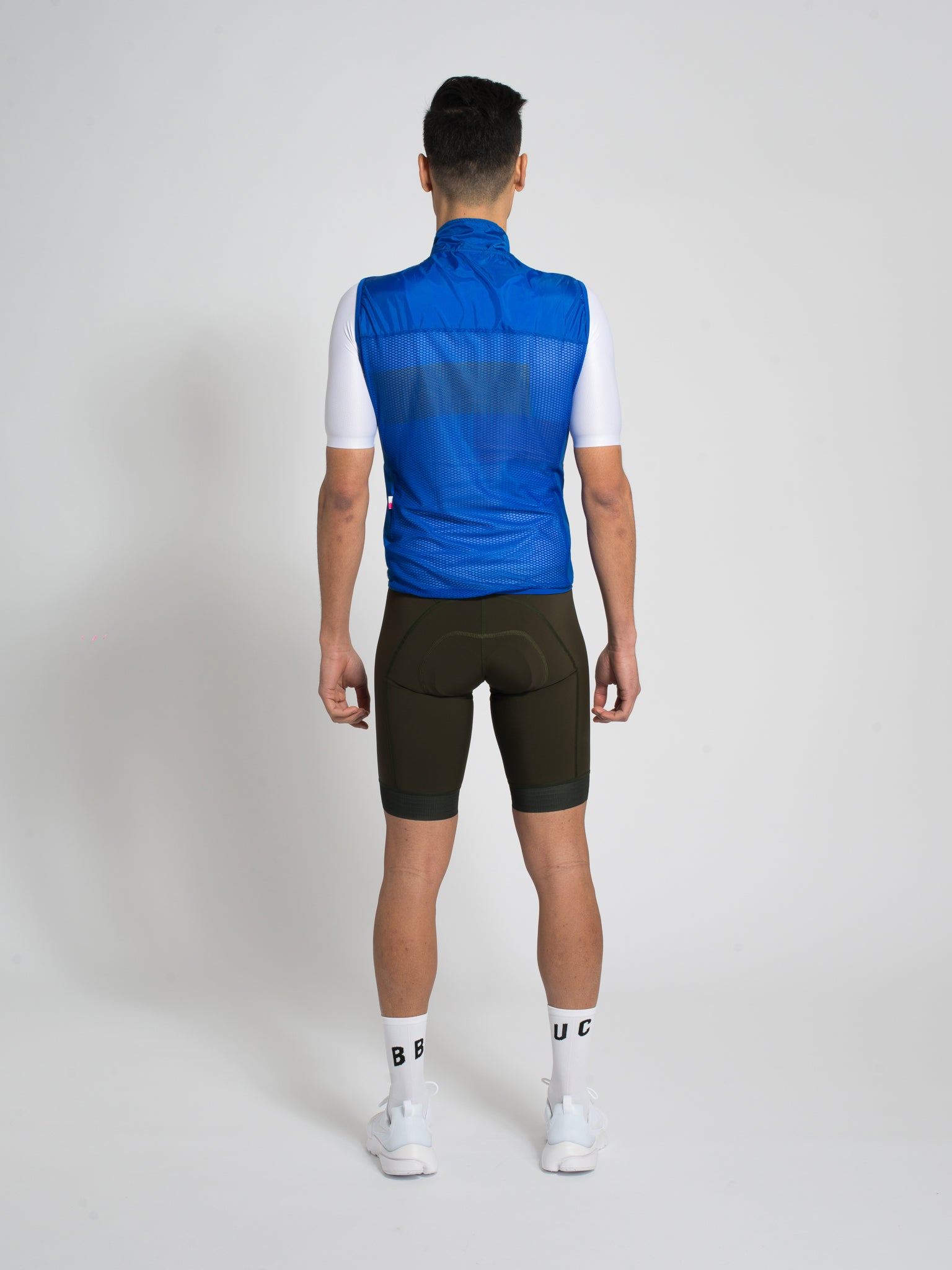Minimalist blue cycling gilet/vest with bbuc logo