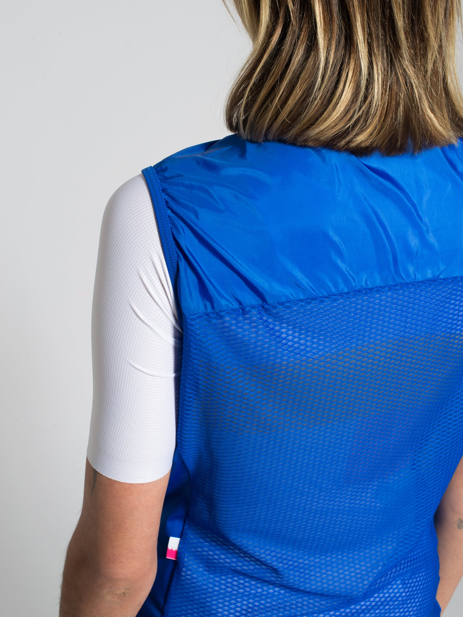 Minimalist blue cycling gilet/vest with bbuc logo for women