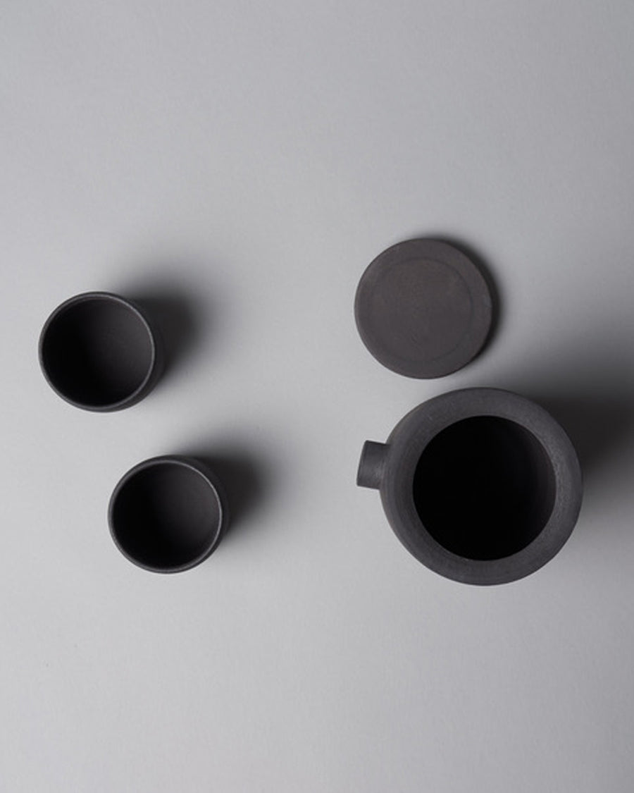 Darcmatter Teapot + 2 cups Black, Darcmatter is an Amsterdam based Ceramic studio run by Denise Rijnen. All Pieces are individually wheelthrown by hand, no two pieces will be identical. Subtle imperfections are celebrated as part of the beauty of each piece