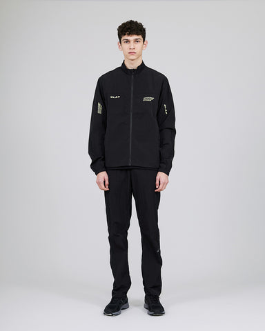 ØLÅF CCC Track Pant Black, Nylon fabric, Two side pockets, Small coin pocket on side, Snap buttons on the hems for adjusting the width , Logo on left leg, Made in Portugal