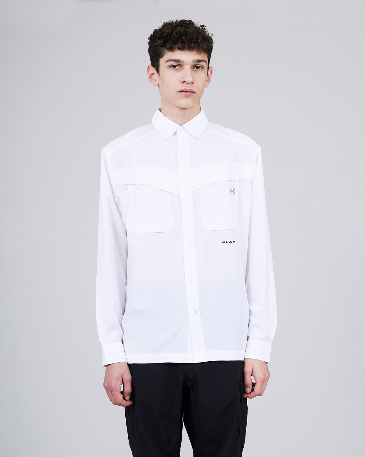 ØLÅF x UA Shirt White, 100% PES fabric, Two chest pockets, Embroidery on left chest, Mesh fabric under armpit for improved ventilation, Made in Jordan