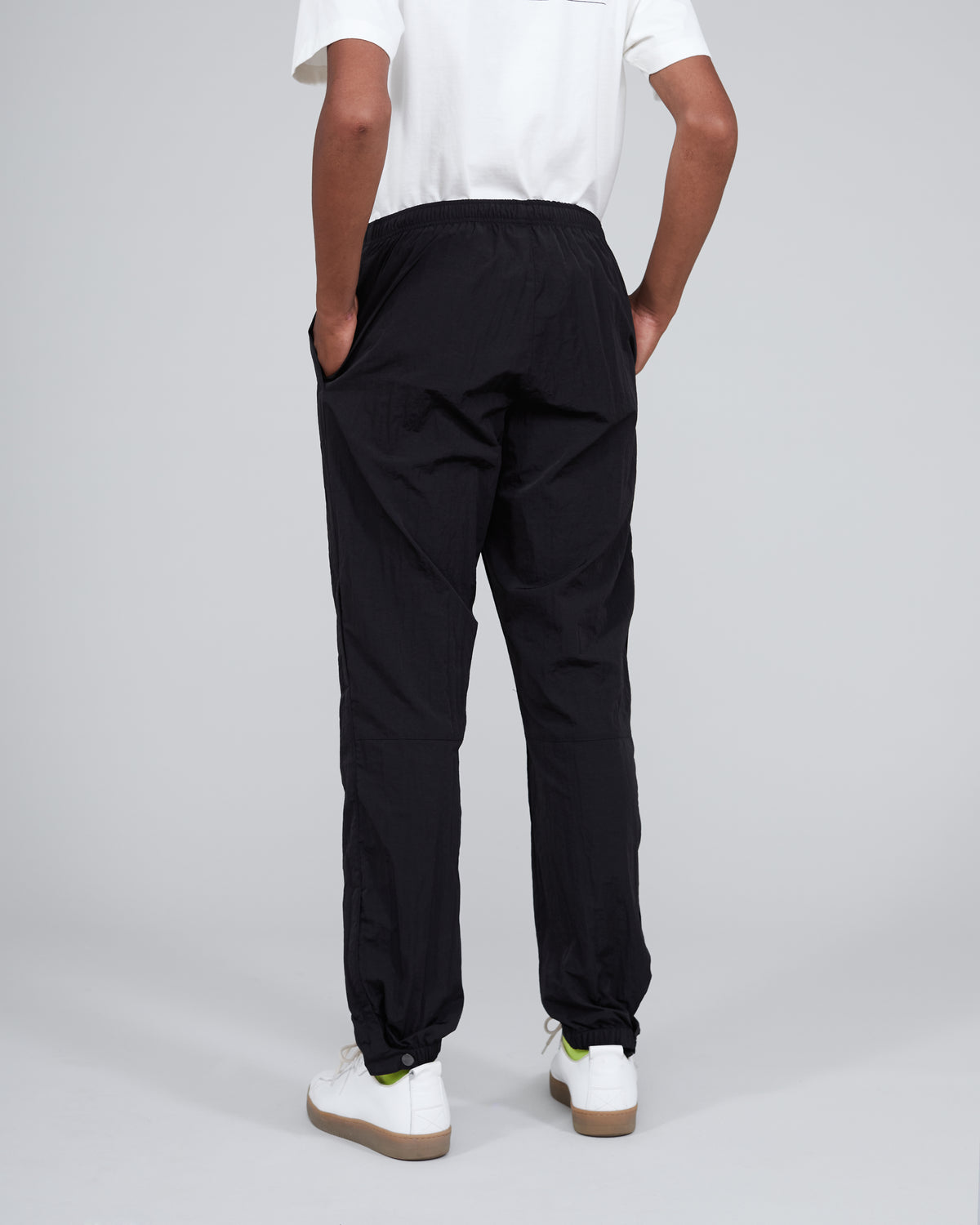 Nylon Track Pants Black, Nylon fabric, Two side pockets, Small coin pocket on side, Snap buttons on the hems for adjusting the width , Logo on left leg, Made in Portugal