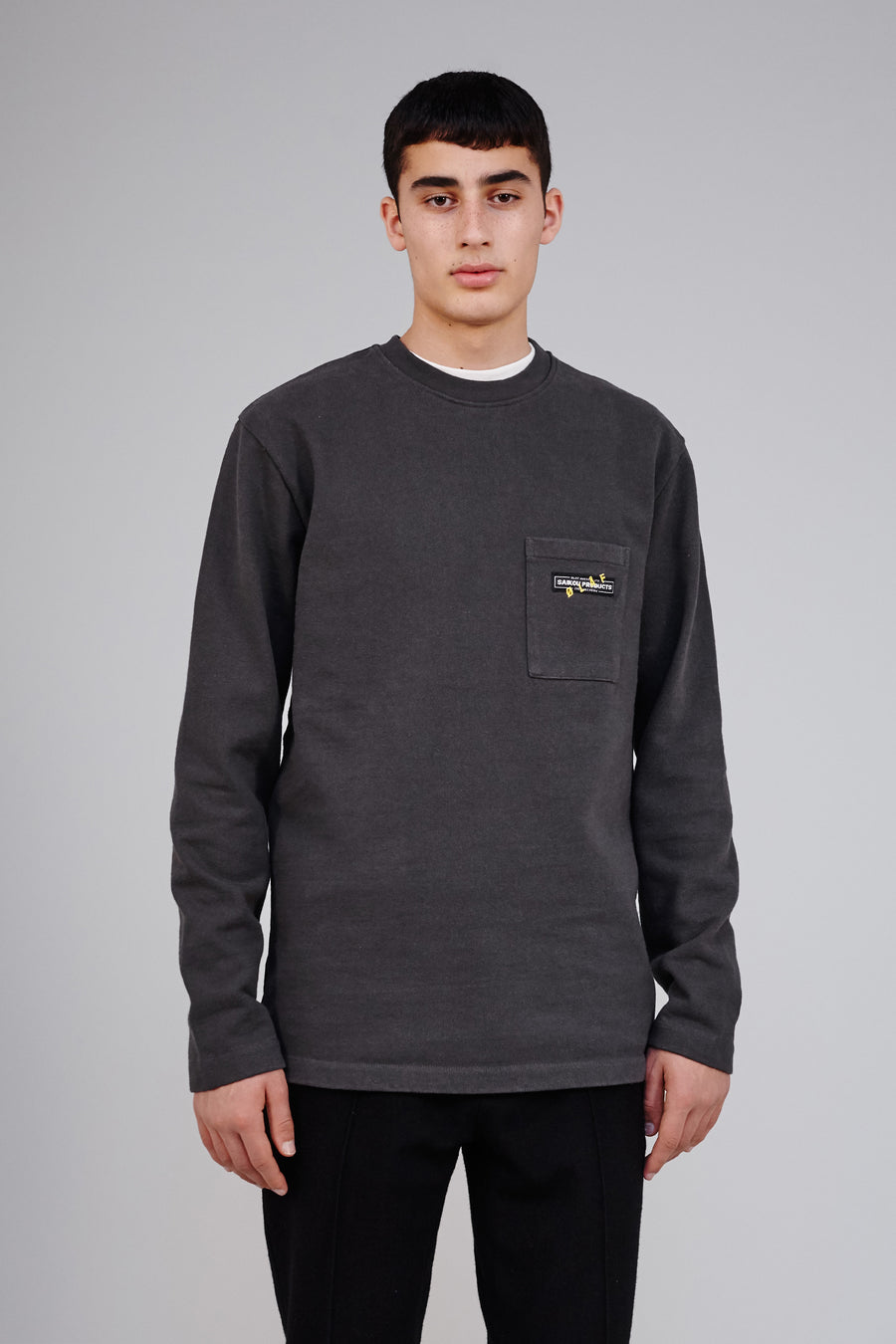 Worker Pocket Heavy Sweater Dark Grey, This dark grey worker sweater has a chest pocket big enough to carry your passport along with your completed VISAS. It features the SAIKOU PRODUCTS label with a yellow ØLÅF embroidery, good for every season.