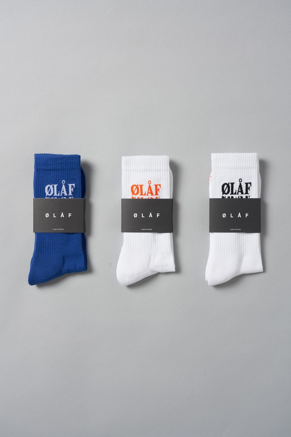 3-Pack ØLÅF Triple Socks Blue / White, 75% Portuguese cotton, 23% polyamide, 2% elastane, Logo on ankle and foot, Made in Portugal.