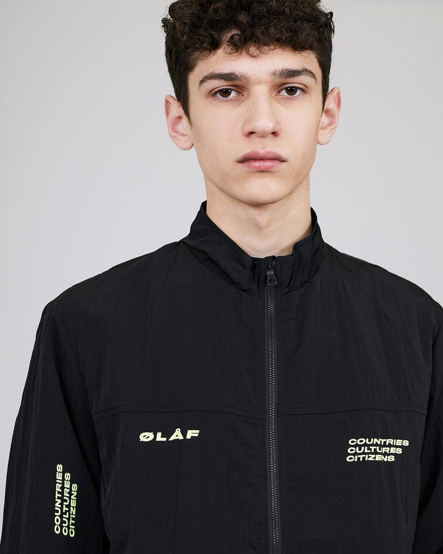 ØLÅF CCC Track Jacket Black, Nylon fabric, Front zipper, Two side pockets, Artwork on left and right arm, Made in Portugal