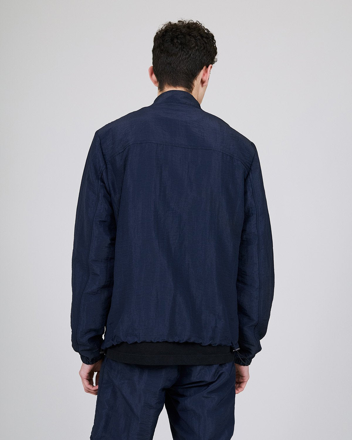 ØLÅF CCC Track Jacket Blue, Nylon fabric, Front zipper, Two side pockets, Artwork on left and right arm, Made in Portugal
