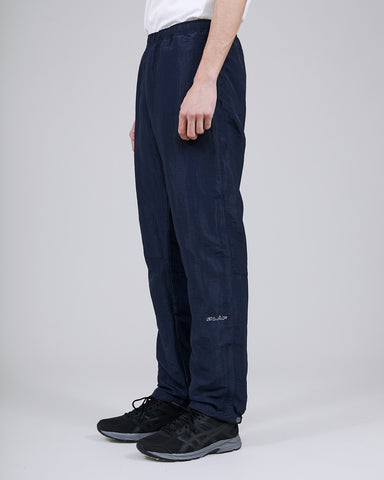 ØLÅF CCC Track Pant Blue, Nylon fabric, Two side pockets, Small coin pocket on side, Snap buttons on the hems for adjusting the width , Logo on left leg, Made in Portugal