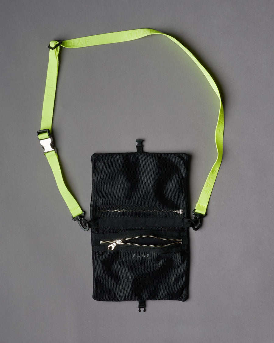Passport BagBlack Neon, made of black Italian nylon. Mesh lining inside. Metal Lampo zippers. Adjustable ØLÅF strap woven in neon. Materials from Italy. Assembled in Portugal, 14 by 28 centimeters. ""