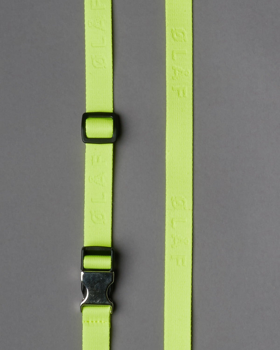 Adjustable ØLÅF Shoulder Strap Neon Yellow, made of our ØLÅF strap woven in neon. Finished with a metal clipper. Compatible with our passport bag. Materials from Italy. Assembled in Portugal,  125 by 2 centimeters.""