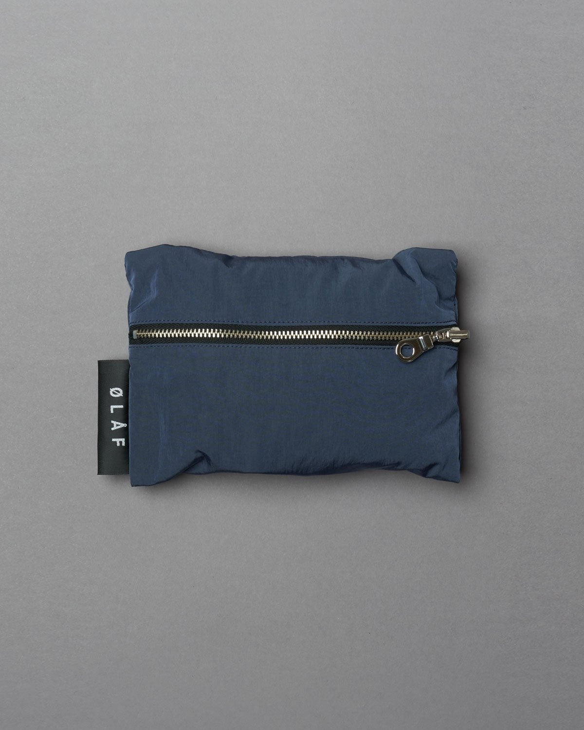 Packable Travel Tote Blue, made of blue Italian nylon. Metal Lampo zippers. Adjustable ØLÅF strap woven in black. Materials from Italy. Assembled in Portugal,  Made in Portugal.""