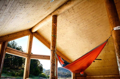 Hammocking in a log cabin
