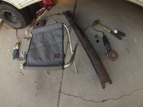 tools and a grand trunk camp stool