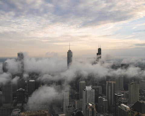 image of clouds drifting across the Chicago skyline @KBUCKLANDPHOTO