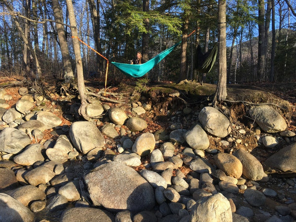 hammocking above a rocky shore