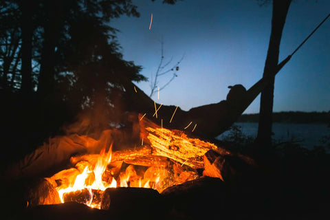 Hammocking next to a lit campfire
