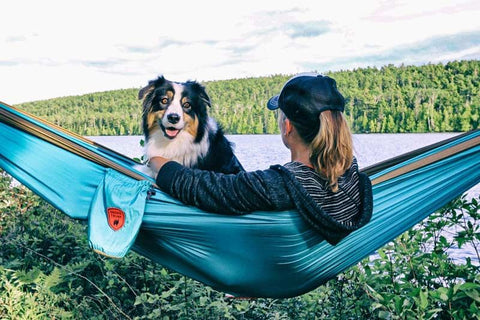 Maria Schultz hammocking with her dog