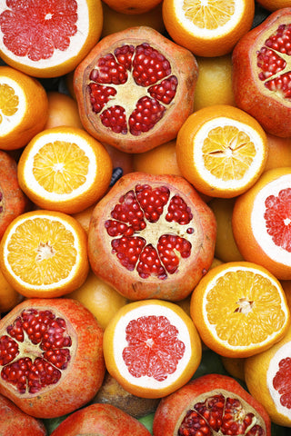 An array of grapefruit and oranges