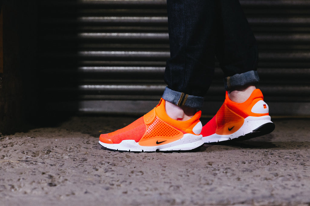 On the foot image of the Nike Sock Dart SE in Total Crimson