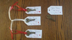 Old keys tied with ribbon to tags.