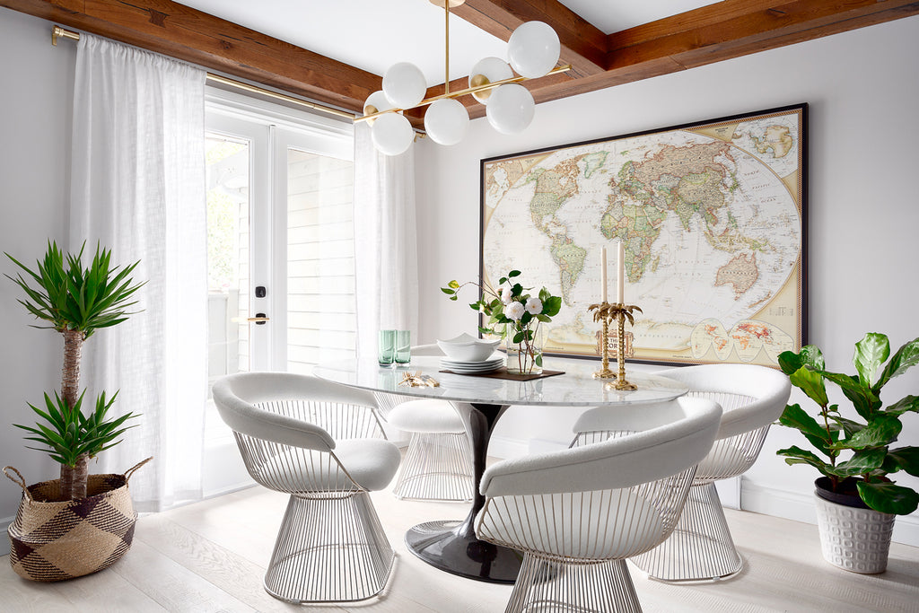 Engineered white oak flooring in a white stain in a dining room in the private townhouse of Karin Bohn with a large map on the wall