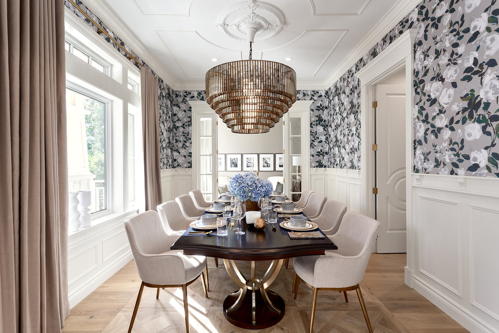 Luxurious dining room in an estate home in Vancouver with gold plated chandelier, floral wall paper and parquet de Versailles