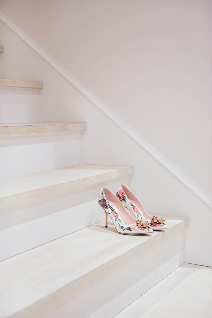 High Heel Shoes on Elegant White Staircase