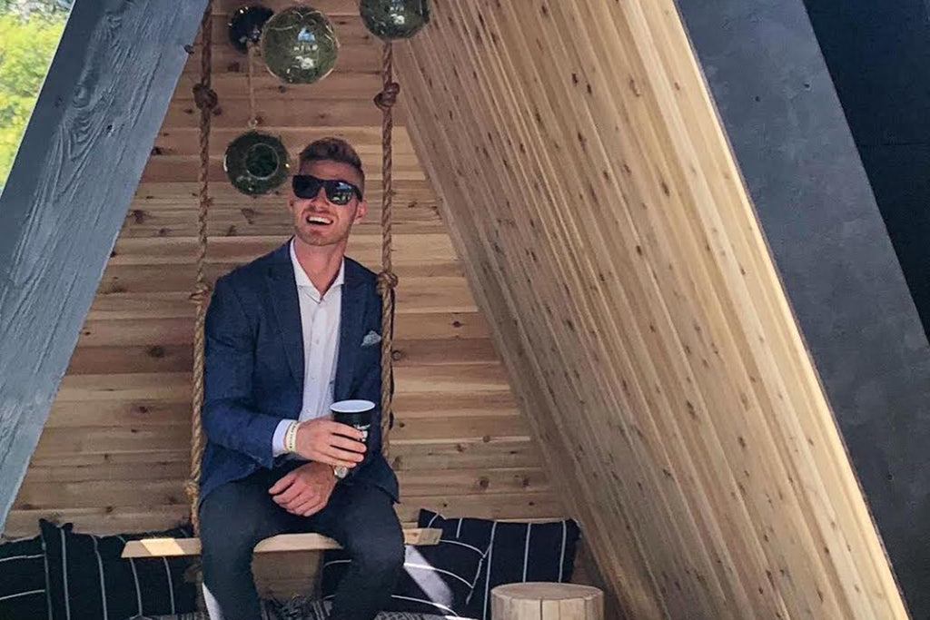 Keegan Morrone, president and CEO of the local architecture and interior design studio AstonMorrone Designs, in the winning reading fort of Barley & Smoke 2019 by Leanne Bunnell and Unique Projects.