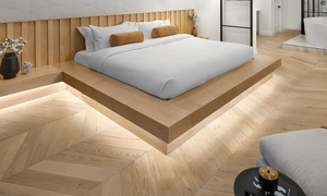 Chevron hardwood installed in a luxurious bedroom with adjoining master ensuite and LED lighting under bed