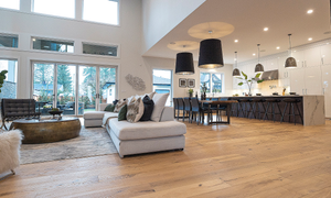 Vernazza plank engineered hardwood installed in a large open space with high ceilings and ample natural light