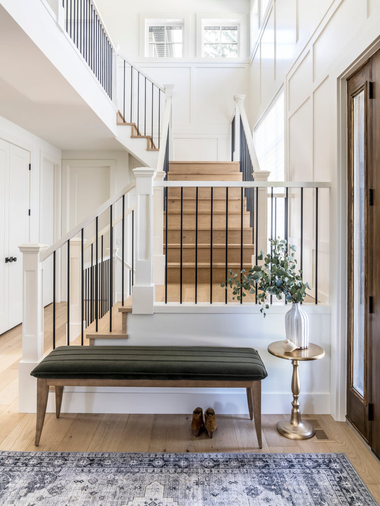 White walls and moulding in a traditional home with natural white oak hardwood on staircase