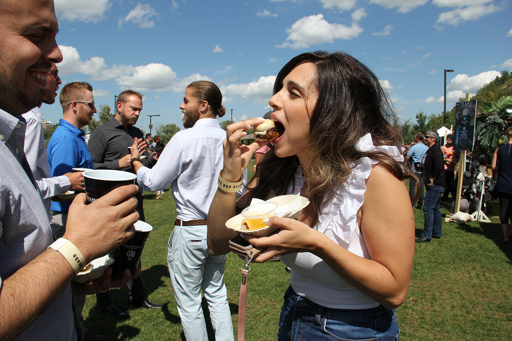 Participant enjoys the entry from local restaurant Cluck & Cleaver at the 2019 Barley & Smoke event