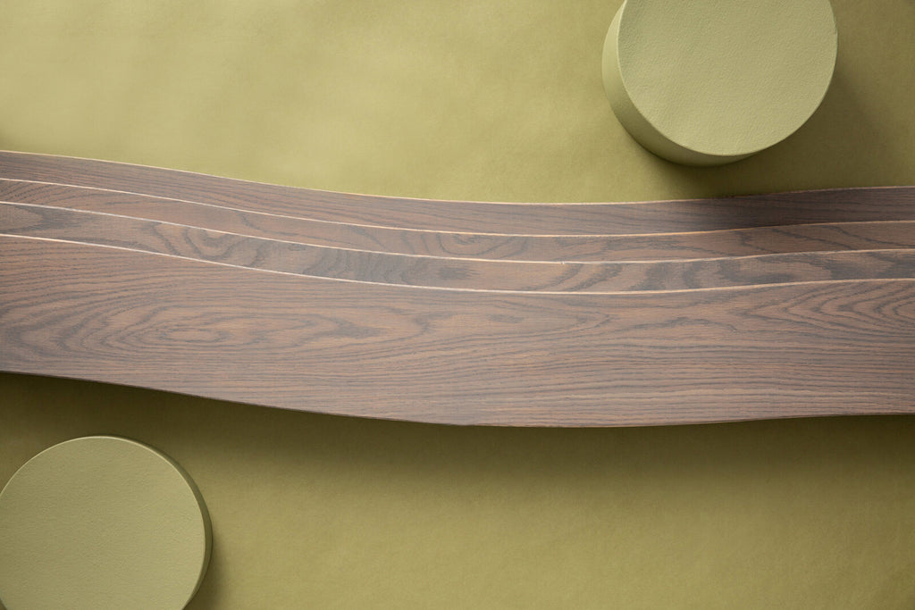 Wave is a curved wooden plank from Wave from the Enigma Collection by Jamie Beckwith