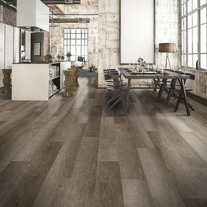 Into the Mystic Loose Lay Vinyl Plank flooring from the Journey Collection by Divine installed in an industrial loft